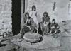 Mary Donlon grinding barley